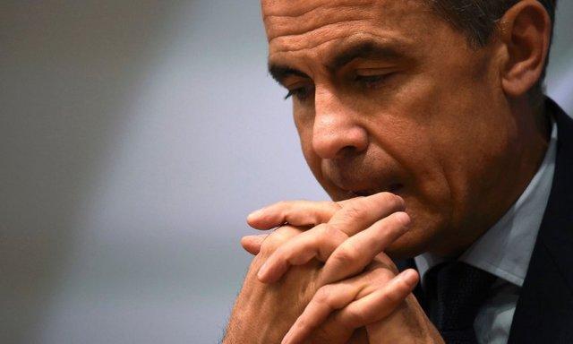 "Sada i Mark Carney iz Engleske banke priča o ""niskom rastu, niskoj inflaciji, niskoj ravnotežnoj kamatnoj stopi"". Foto: Dylan Martinez/AFP/Getty Images, The Guardian"